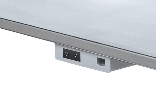 Op-ned kontakt i hæve-sænkebordets forkant